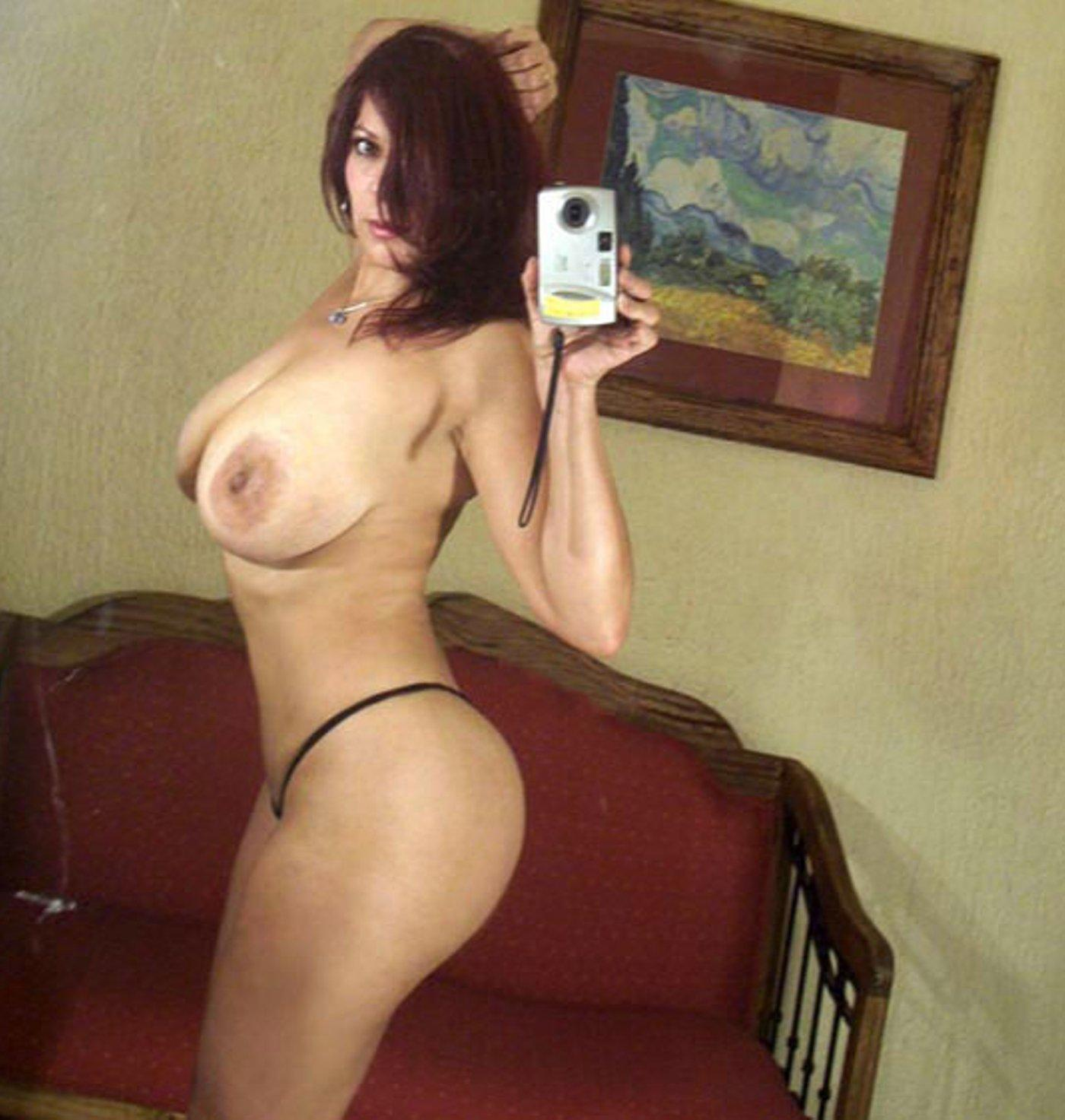 Mexican Milf shows her huge tits while taking mirror nude selfie. Sexy Maritza Mendez takes a self shot while posing without a bra