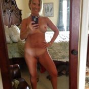 Skinny mature naked selfie in the mirror
