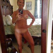 Skinny mature naked selfie in the mirror