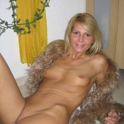 Beautiful naked MILF poses erotic