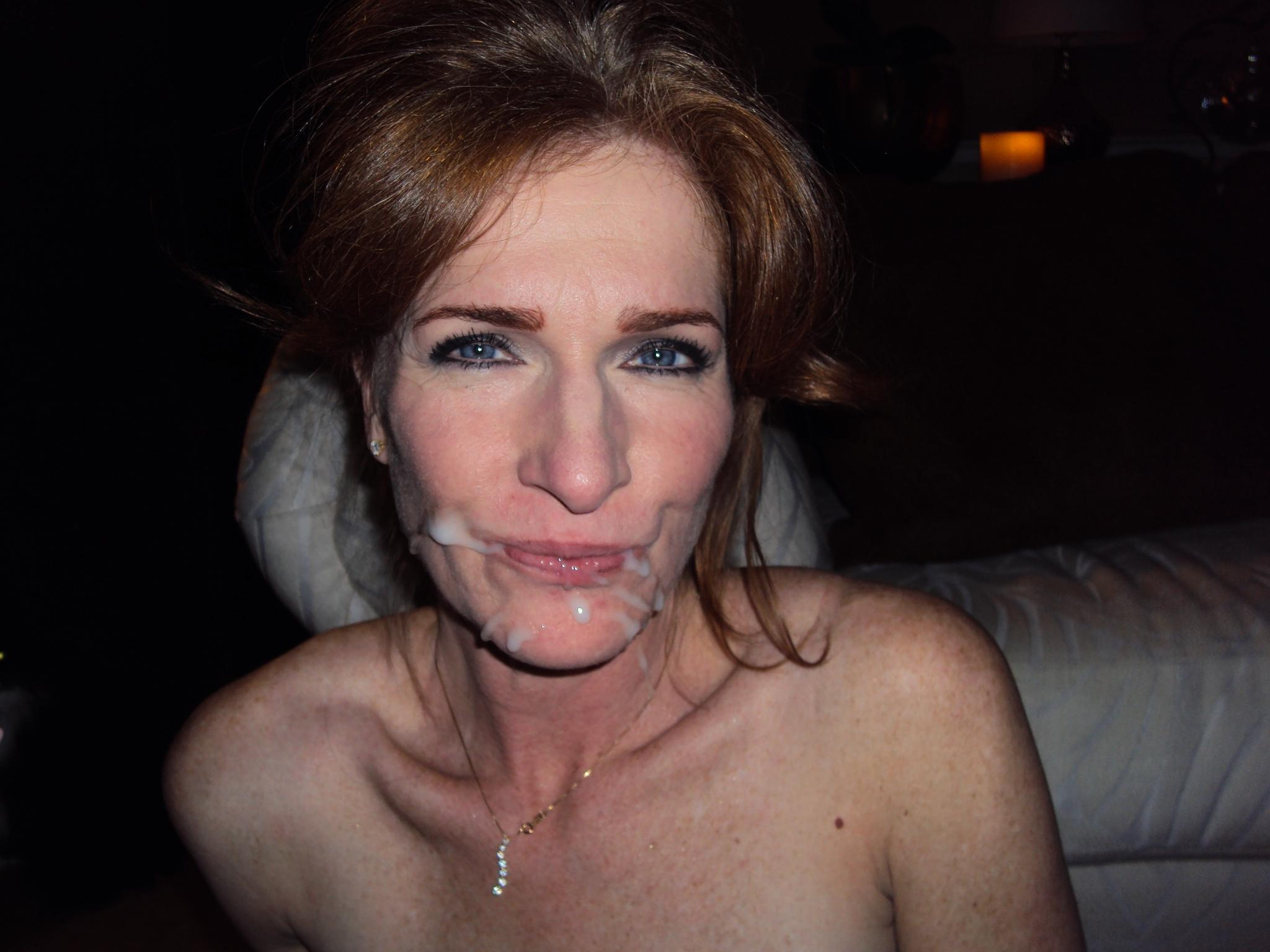 Redhead housewife drips jizz from her mouth after a hard homemade fuck. Hot amateur MILF licks the cum from her lips after a blowjob