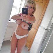 Big boobed MILF takes naked selfie