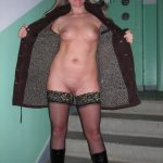 Young MILF poses in coat and flashes her great boobs and shaved pussy on the staircase. Female exhibitionist exposes herself in public in a coat & shades
