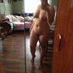 Chubby mature wife presents herself as nature created her in the mirror. Amateur fat senior take totally naked selfie in the mirror
