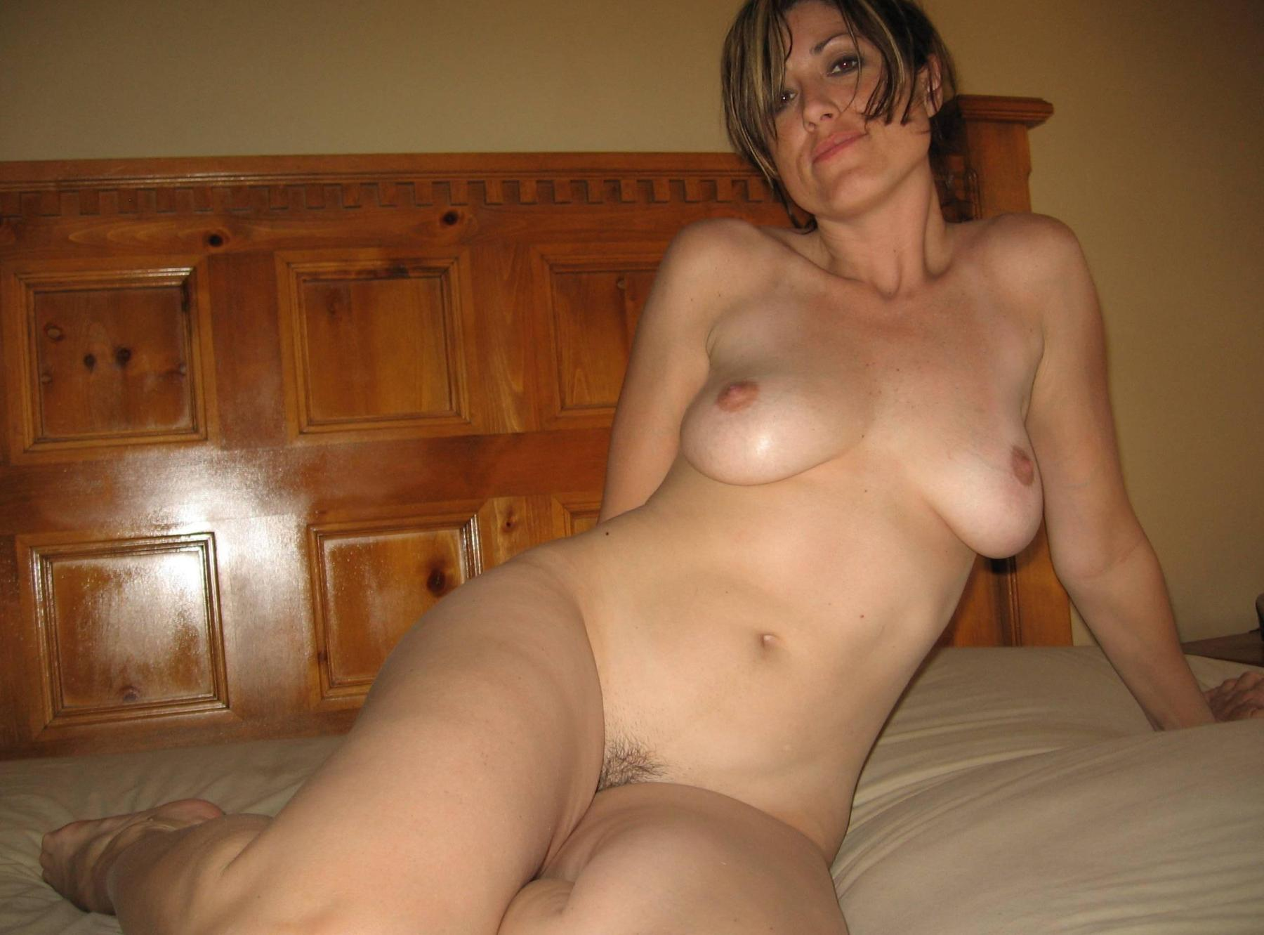 Beauty MILF does an amazing striptease where she shows off her goods. Amateur cougar flaunts shaved pussy and natural tits in the bed