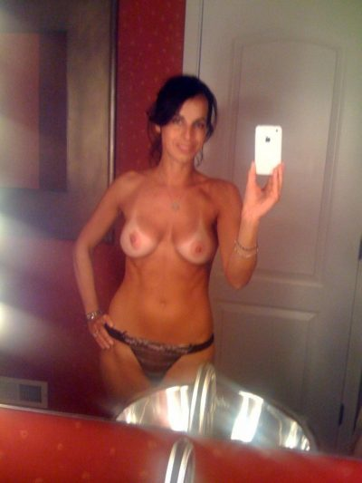 Tanline selfshot MILF taken after visiting the beach. Very nice busty women with tanlines baring big natural tits in front of the mirror