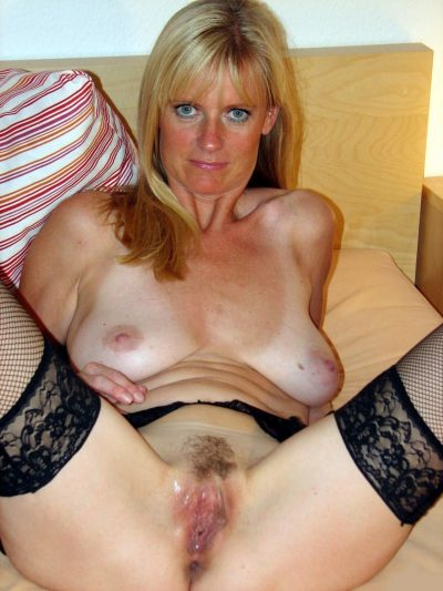 Old women opens her legs wide and displays her wet pussy. Bedtime always makes mature amateur, so she spreads her pussy lips on the bed