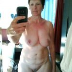 Sexy nude amateur Milf in homemade selfshot. Beautiful mature woman completely naked in front of a mirror takes homemade selfie