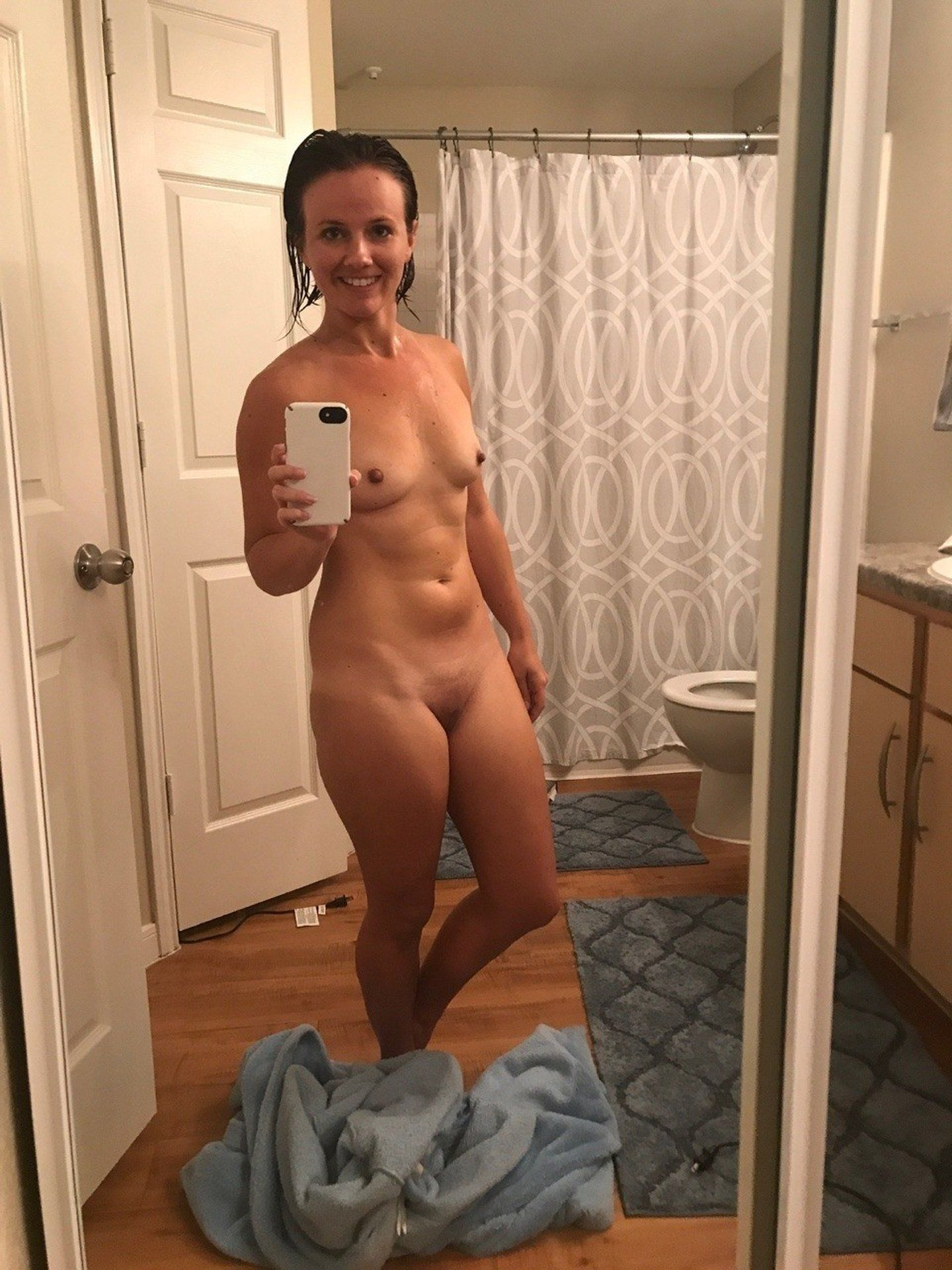 Naughty MILF reveals her gorgeous body in the bathroom. Ravishing amateur wife takes picture of her juicy body by herself