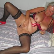Horny granny fingering her hungry pussy