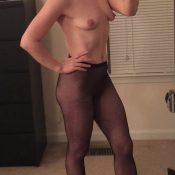 Middle-aged beauty in pantyhose takes mirror selfie