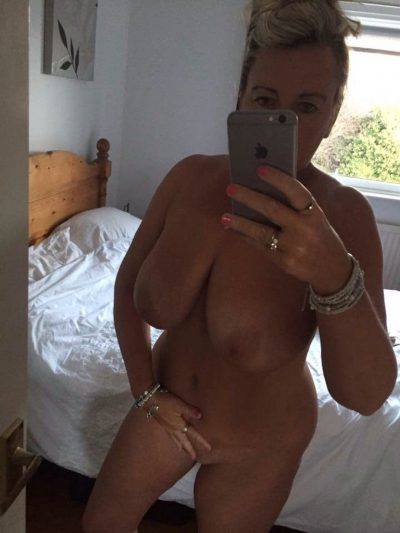 Nude British Milf loves taking selfies of attractive naked body. Hot chubby mom snaps off selfie in the mirror