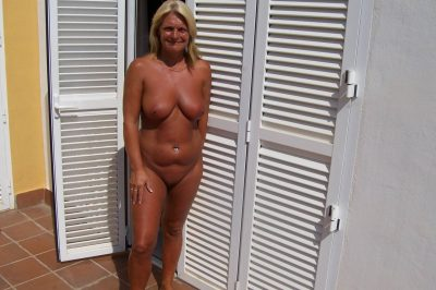 Naked elderly woman reveals her nice boobs and juicy vagina. Alluring MILF blonde is tanning her natural body