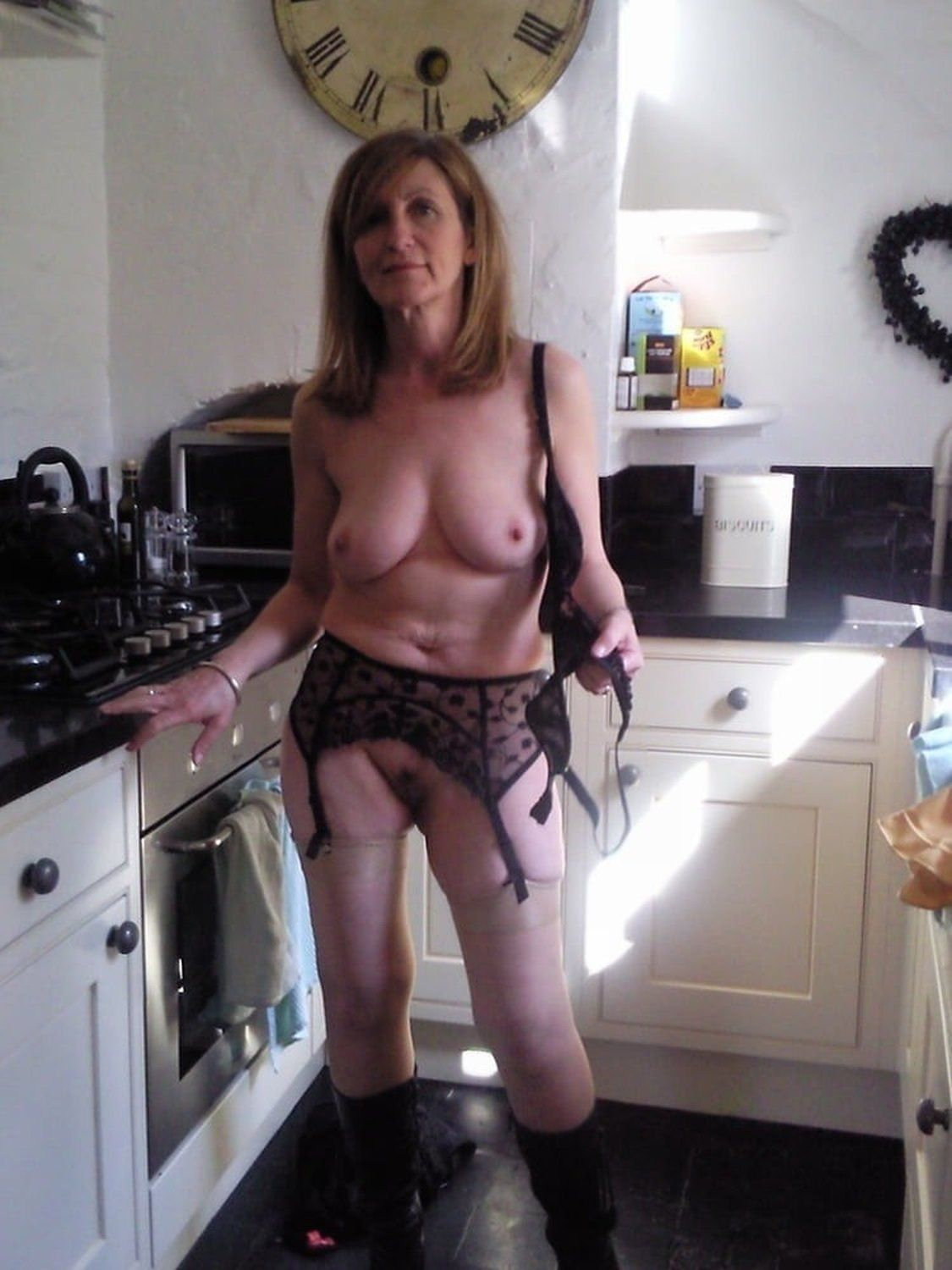 Seriously hot milf stripping off her lingerie and posing naked. Graceful amateur wife exposing natural tits and hairy pussy