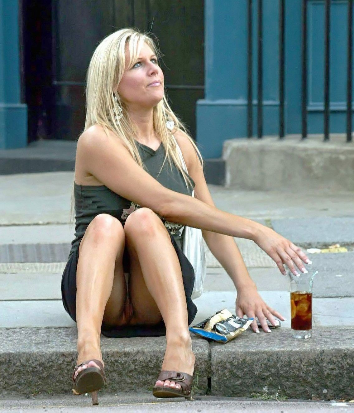 Sexy MILF was caught out of panties in a public place during breakfast. Hot blonde cougar without panties in public