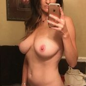 Cougar removes her bra and panties for nude self shot