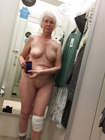 Naughty granny takes a nude selfie while expoing her shaved pussy and tits. Sexy old lady bares her natural boobs during self shot action