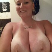 Busty MILF takes selfie of her big natural boobs