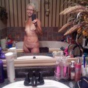 Hot granny taking self shot in the bathroom