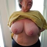 Hot old lady praises her huge natural breasts in privat picture. Naughty old granny shows off big tits naked