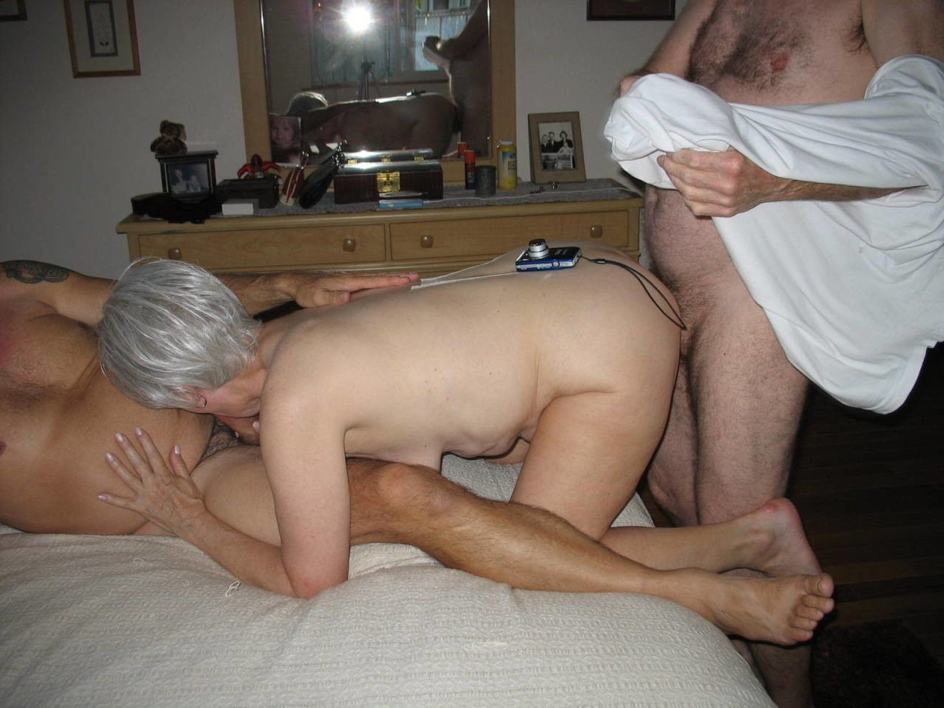 Amateur mature moans in pleasure in her first DP threesome. Old lady with saggy tits takes two boners at the same time