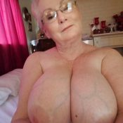 Naked grandma tempts with her huge tits