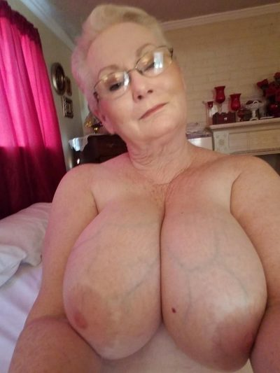 Naked grandma revealing huge all natural tits for self shot. Amateur granny loves taking selfies of attractive nude body