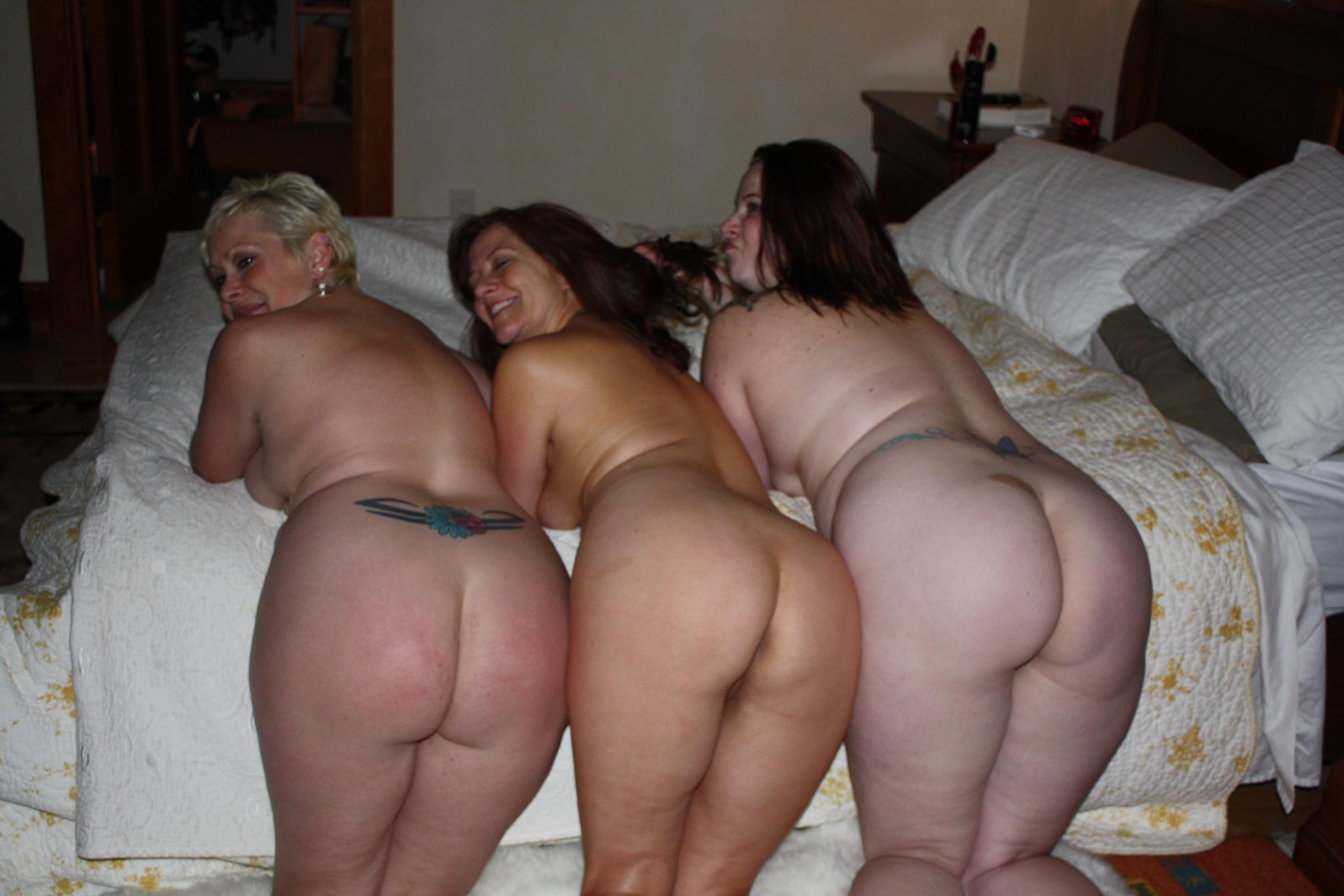 Naked mature women boldly present big asses in all their glory. Three nude ladies show their fluffy asses very erotically