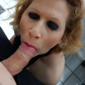 Horny mom gives a blowjob in the bathroom