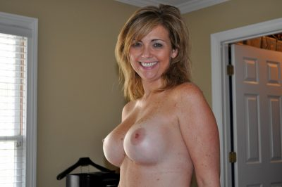 Sexy milf strips on the home & shows her natural huge tits. Pretty amateur wife without a bra shows off her perfect breasts