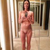 Slim mom takes a selfie naked