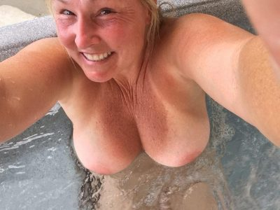 Nude beautiful mom without a bra takes a erotic selfie. Sexy busty mature milf flashes her huge tits while relaxing in the jacuzzi