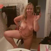 Sexy Mature undressing in the bathroom to show herself