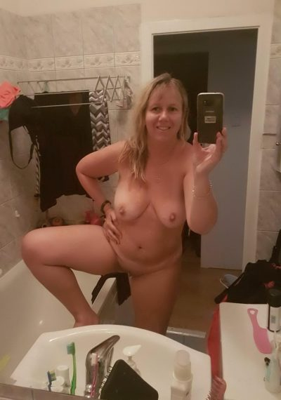 Hot wife undressing in the bathroom to show herself. Sexy mature amateur snaps off selfies while flashing her nude body