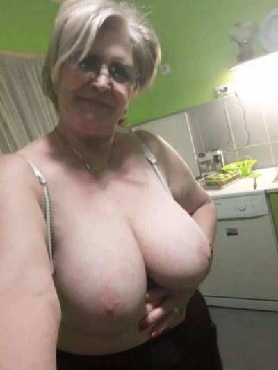 Beautiful granny takes self shots of her big natural boobs. Nude grandma with huge tits takes a erotic selfie