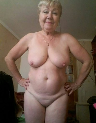 Playful naked russian granny bares her natural boobs. Curvy mature from Russia exposes her big tits & shaved pussy