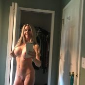 Busty MILF takes a selfie naked