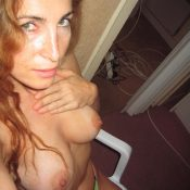 Sexy mom bares her big boobs during self shot action