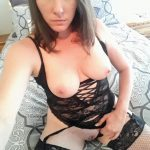 Terrific MILF taking selfshot of huge natural breasts and shaved pussy. Amateur wife in lingerie gets naked and does coos self-shot