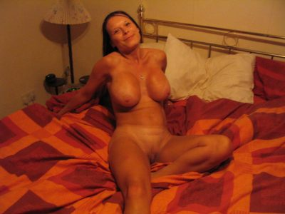Glamorous MILF showing off her juicy perfect boobies & her shaved pussy. Naked busty mom poses extremely erotic on the bed