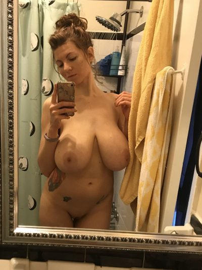 Big boobs presented by the gilf look great. Sexy milf with huge breasts standing in front of the mirror shoots erotic nudes