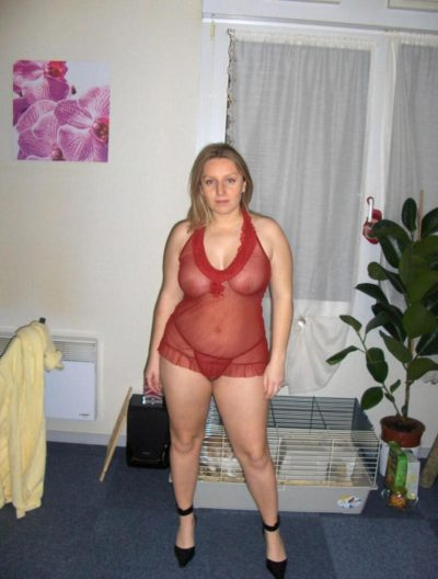 Mature amateur in a very naughty version. Erotic mom in see-through lingerie and long high heels poses very sexually